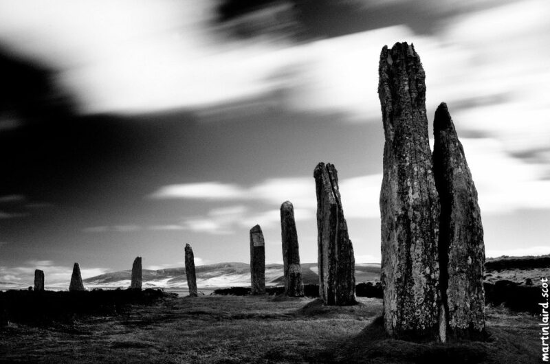Photo of the Ring of Brodgar, black and white long exposure with clouds on a windy day, by Martin Scott Laird.