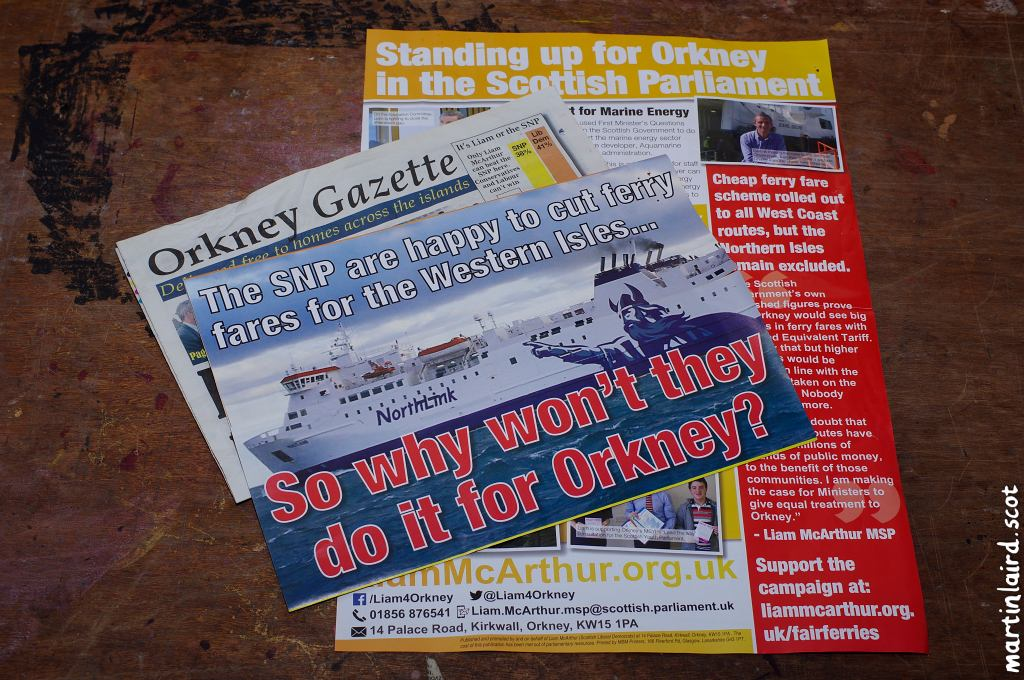 "Photo of various election pamphlets received in the run-up to the 2016 Scottish Parliament elections. Ferry fares feature prominently. One is a fake newspaper called the ""Orkney Gazette."""