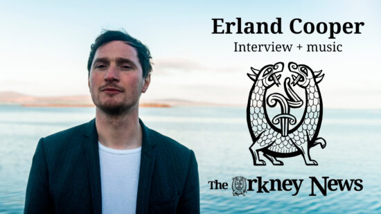 Erland Cooper - Orkney News interview. Picture of Erland in Orkney with the sea behind him.